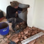 Preparing fireplace opening for lintel and hearth
