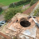 Removing oil gas flue ready for new chimney pot
