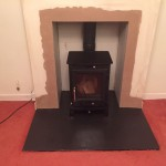 FInished stove installation ready to paint with 25mm slate hearth cut to size