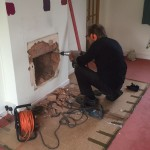Work commences excavating fire place